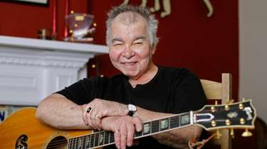 John Prine poses in his office in Nashville,