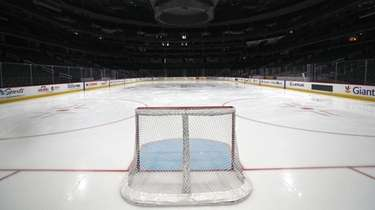 A goal sits on the empty ice prior
