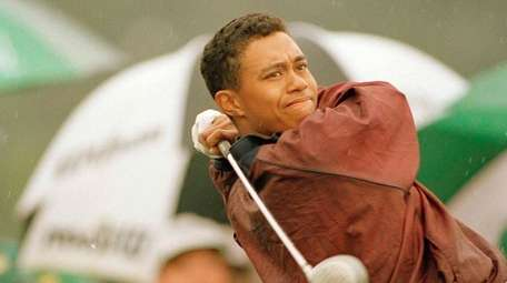 Tiger Woods, 19, rips a drive on the