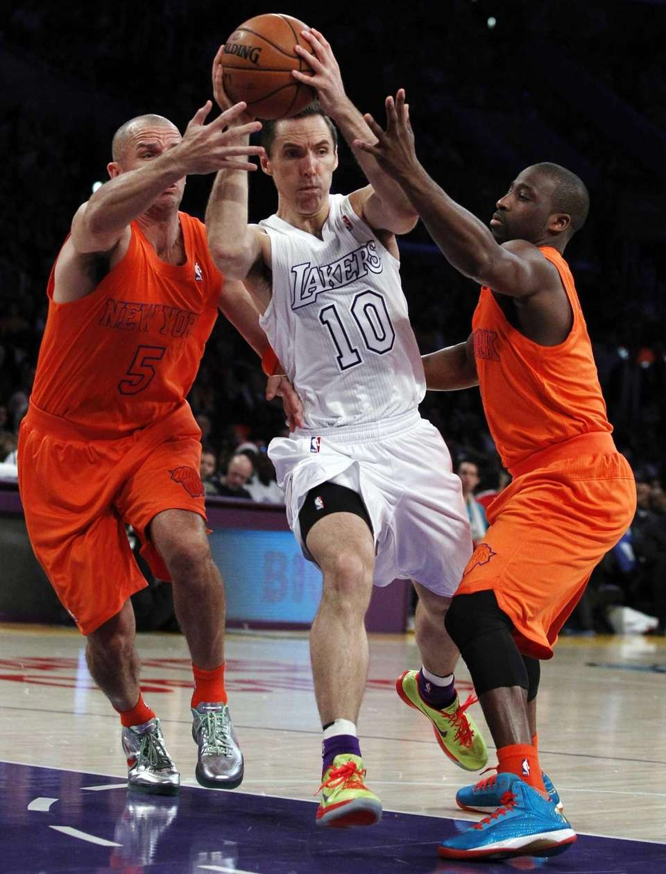 Los Angeles Lakers guard Steve Nash, center, drives