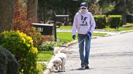 Pet sitter Beth Goldin walks client Buddy in