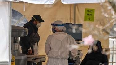 A health care worker in an hazmat suit