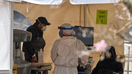 A health care worker in an hazmat suit