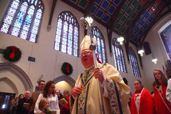 Bishop William Murphy conducts Christmas Mass at St.