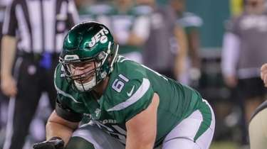 Jets offensive guard Alex Lewis lines up during