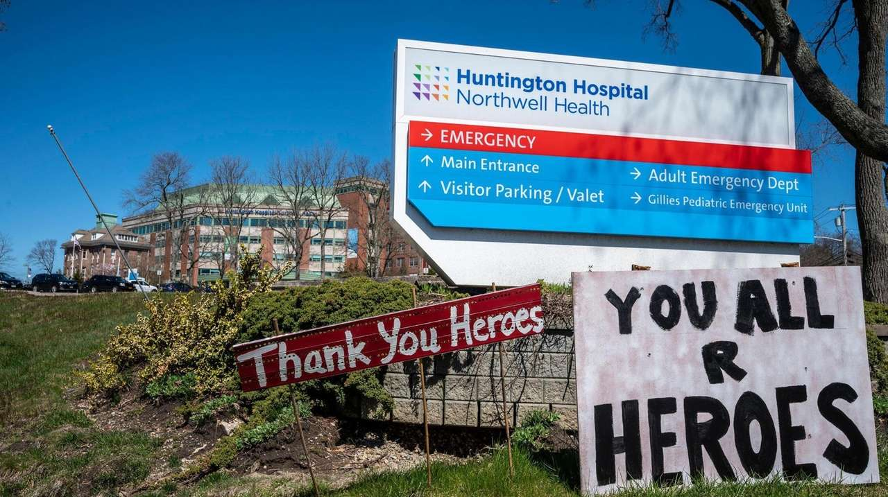 Signs outside Huntington Hospital on Saturday.