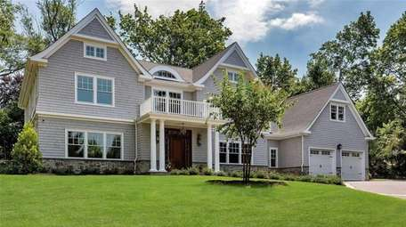 Priced at $2,998,000, this newly constructed six-bedroom, 5½-bathroom