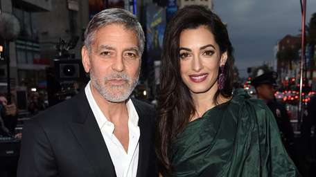 George and Amal Clooney attend the premiere of