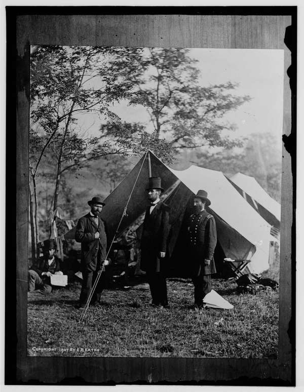 President Abraham Lincoln stands in the center in