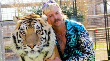 "Joseph ""Joe Exotic"" Maldonado-Passage appears with one of"