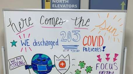 A lobby bulletin board at Huntington Hospital celebrates