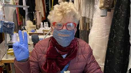 Nancy Sinoway, a Port Washington dressmaker, makes surgical-style