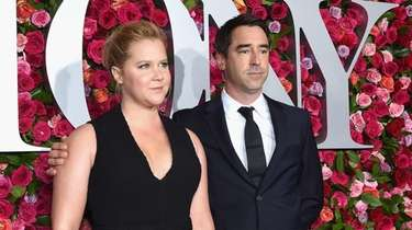 Amy Schumer and husband Chris Fischer attend the