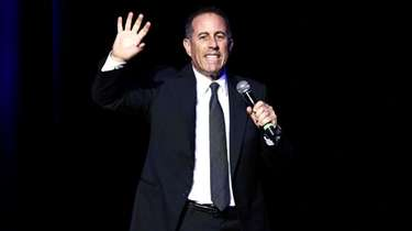 Jerry Seinfeld performing at the Beacon Theatre in