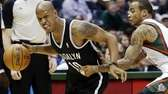 Brooklyn Nets' Keith Bogans tries to drive past