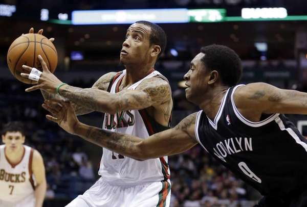 Milwaukee Bucks' Monta Ellis drives past Brooklyn Nets'