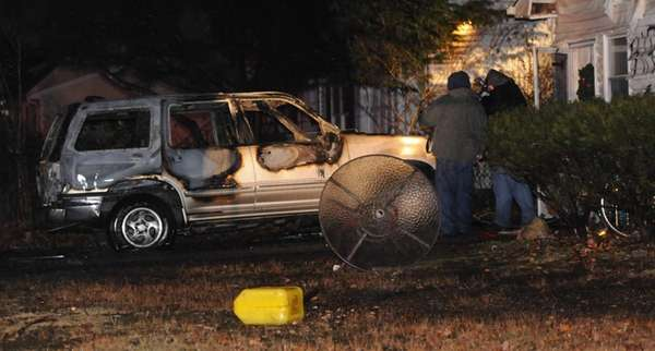 Suffolk County police arson investigators probe suspicious vehicle