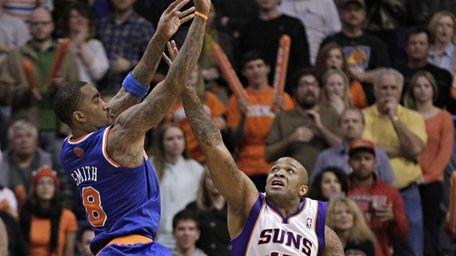 New York Knicks' J.R. Smith shoots the game-winning