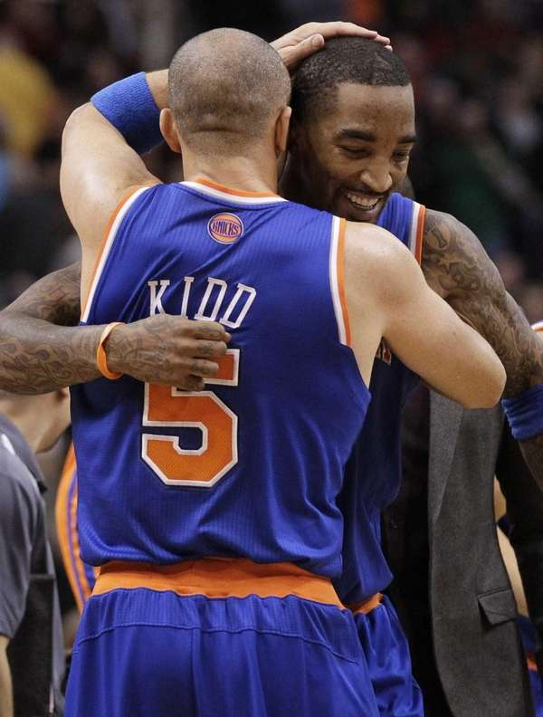 Jason Kidd (5) celebrates with teammate J.R. Smith