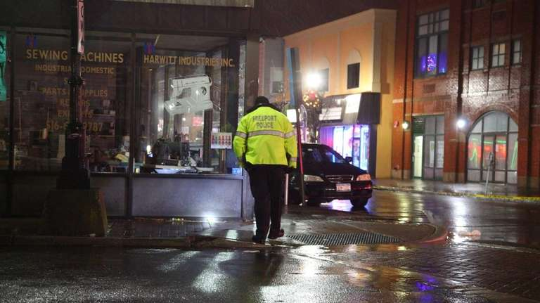 Freeport police search the scene of a shooting