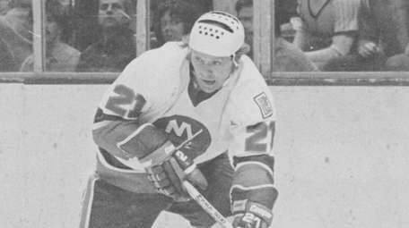 Butch Goring of the Islanders comes around the
