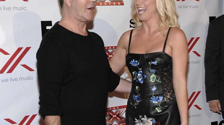 Britney Spears and Simon Cowell attend an