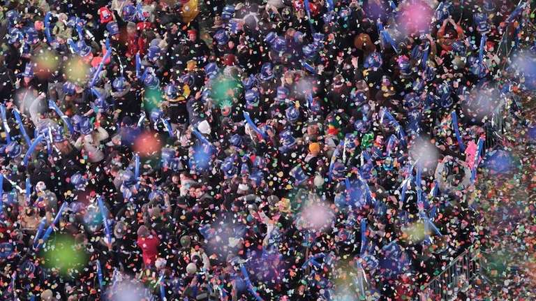 Confetti is seen falling over revelers in New