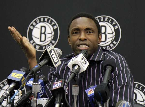Former Nets head coach Avery Johnson talks to