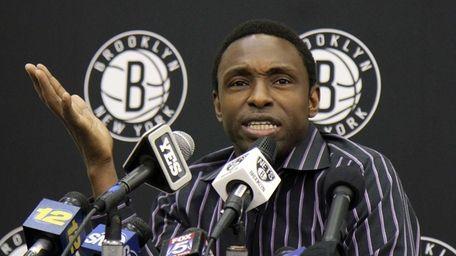 Former Nets head coach Avery Johnson talks to