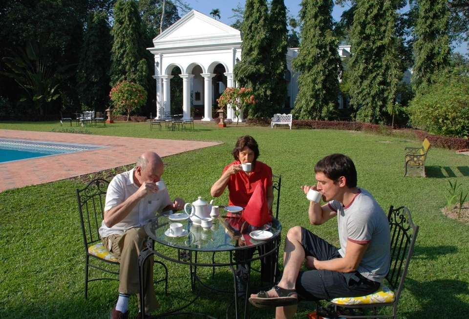 People sip afternoon tea on the lawn of