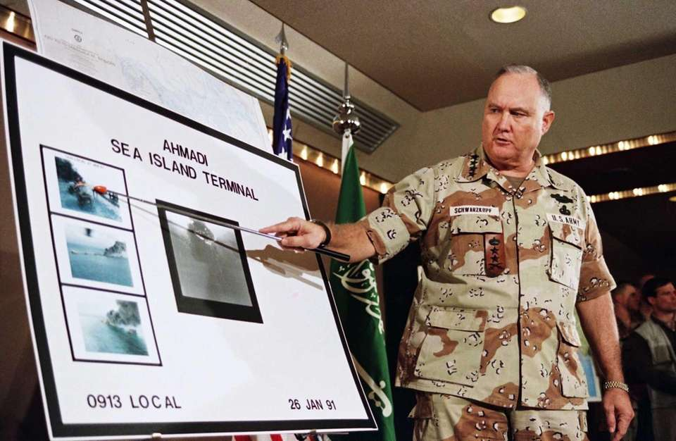 U.S. Army Gen. H. Norman Schwarzkopf points to