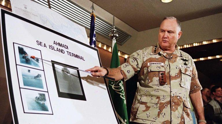 U.S. Army Gen. H. Norman Schwarzkopf points to