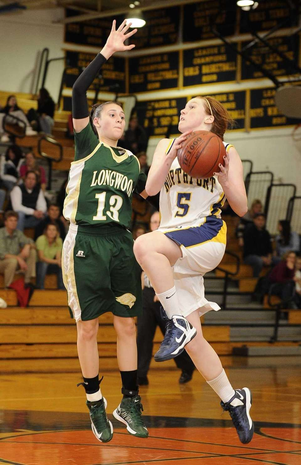 Northport guard Lizzy Atkinson drives in for a