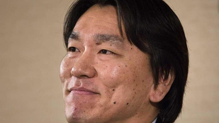 Hideki Matsui smiles during a news conference to