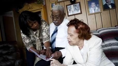 Delores Jenkins, 62, goes over a medical report