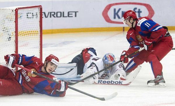 Team USA goalie John Gibson, center, battles for