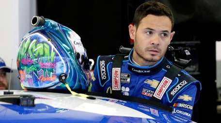 Kyle Larson gets ready to climb into his