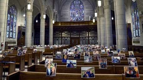 Parishioners' photos are seen in the pews as
