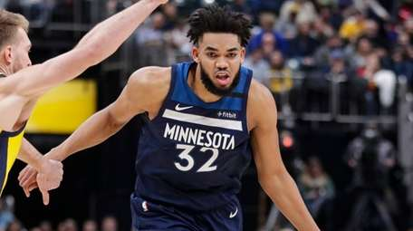 Timberwolves center Karl-Anthony Towns drives around Pacers forward