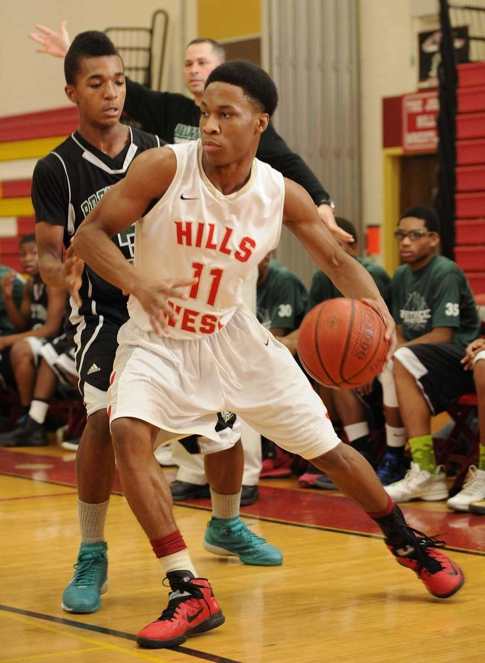 Half Hollow Hills West guard Tyrell Ryan drives