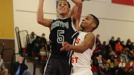 Brentwood point guard Michael Almonacy shoots and is