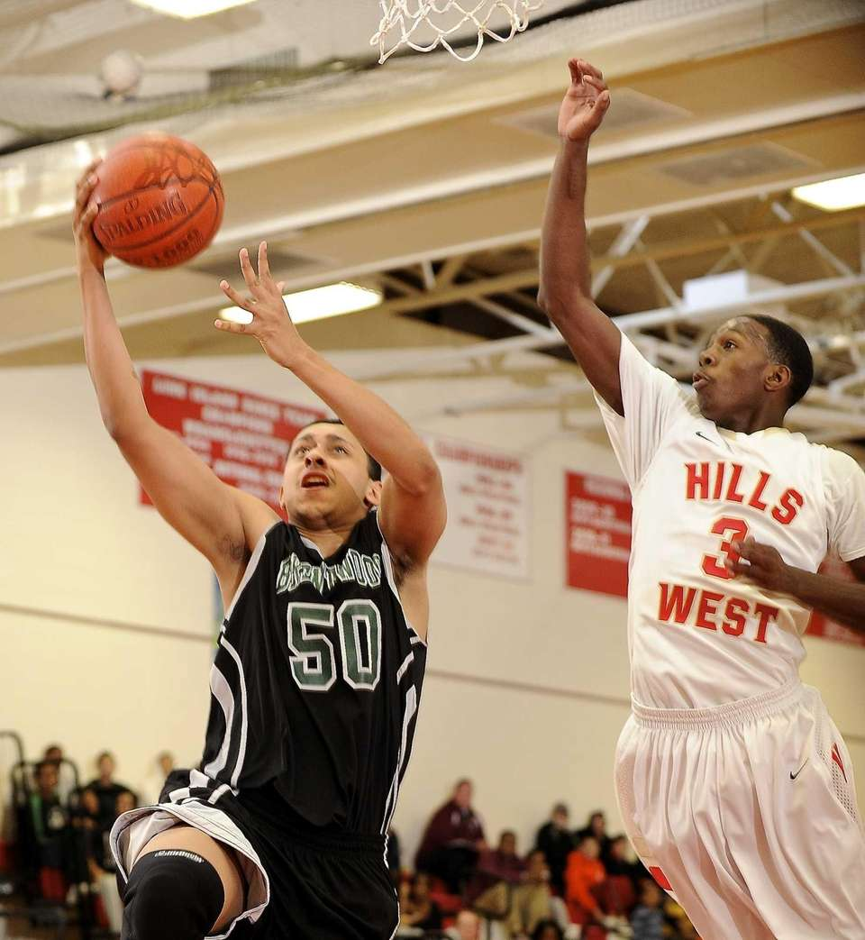 Brentwood's Michael Certain shoots guarded by Half Hollow