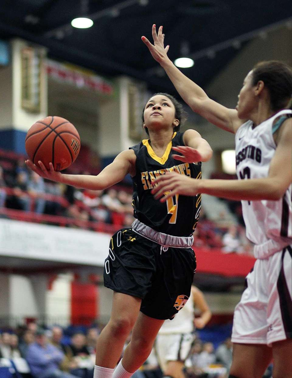 St. Anthony's Tyla Parham goes under the basket