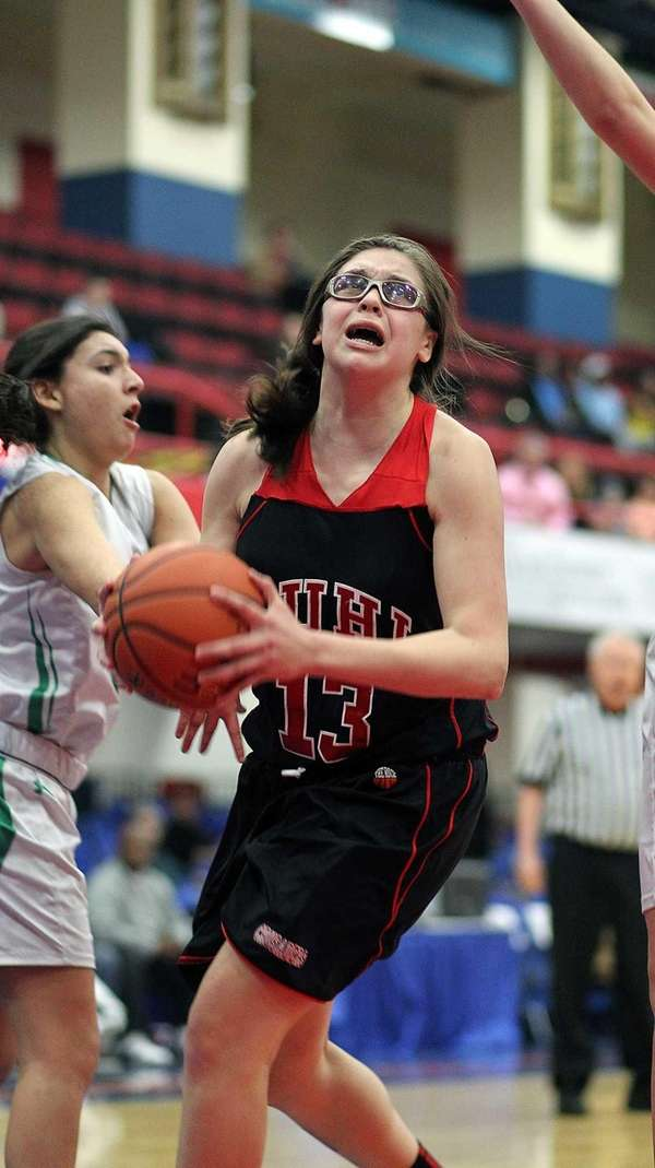 Lutheran's Taylor Byrne gets under basket during a