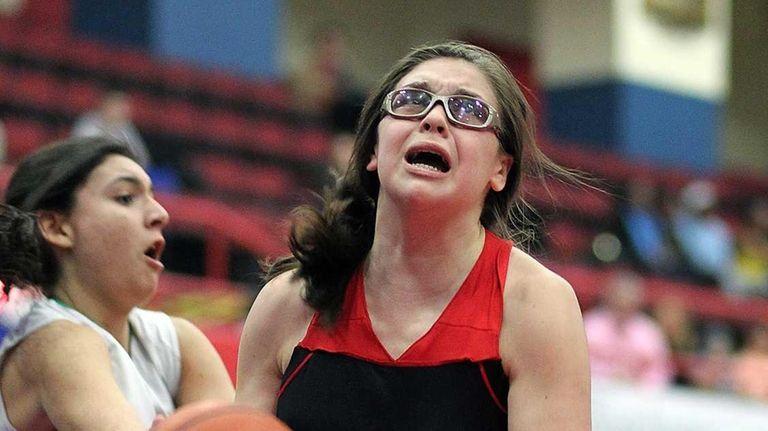 Lutheran's Taylor Byrne gets under basket during a