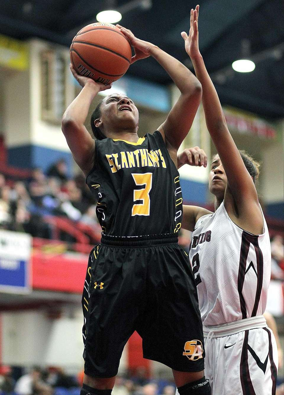 St. Anthony's Charise Wilson shoots underneath against Ossining