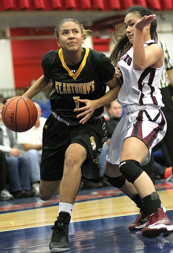 St. Anthony's Chastity Taylor goes against Ossining's Dainelle