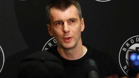 Brooklyn Nets owner Mikhail Prokhorov speaks to reporters