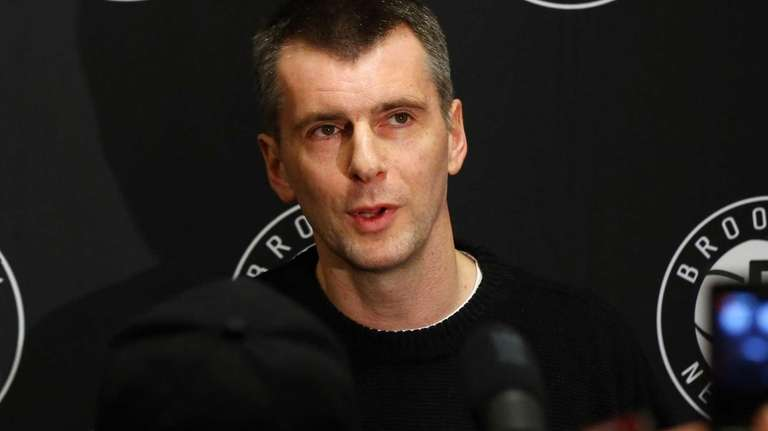 Brooklyn Nets owner Mikhail Prokhorov speaks to reporters