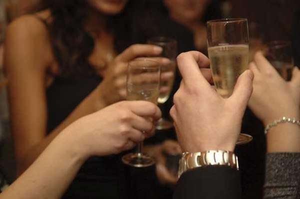 Toasting champagne for New Year's Eve home parties.